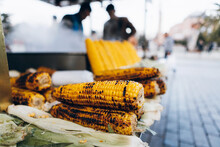 Raw And Grilled Corn Cobs On S...