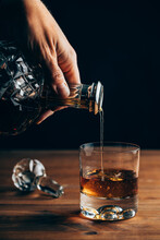 Crop Person Pouring Whiskey In Glass