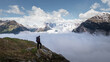 Man standing alone above the clouds in the Swiss Alps