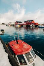 Boat Near Pier In Coastal Town