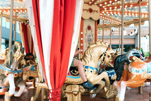 A Child On The City Carousel.
