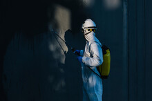 Closeup Of A Firefighter Disinfecting The Walls Of A Building