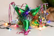 Traditional Colorful Pinata, Christmas Lights And Christmas Tree. Christmas Decoration