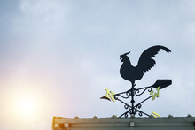 Wind Direction Indicator And A Rooster Compass On The Roof