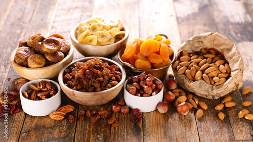 nuts and dried fruit on wood background Fototapet