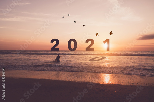 New year 2021 is coming with sunset beach background. New start for planing or set new resolution in life.