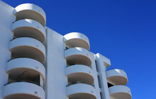 Low Angle Shot Of Modern Architecture In  Ibiza, Spain On A Clear Sky Background