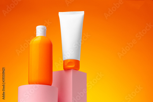 Fototapeta Skincare beauty products container against pink background obraz
