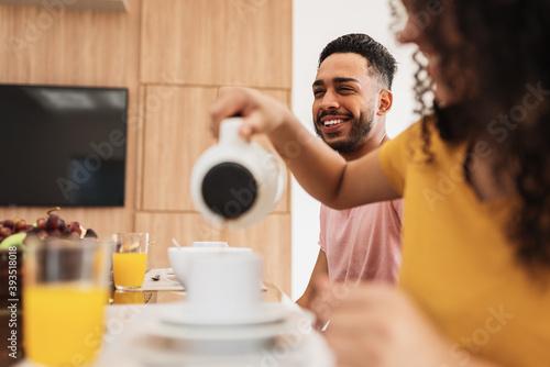 Fototapeta Latin American family having breakfast at home obraz