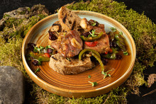 Fried Pork With Grilled Vegetables. A Hot Dish Of Meat And Vegetables.