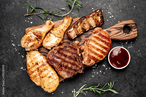 Fotografiet Various types of grilled meat, beef, pork, chicken on stone background
