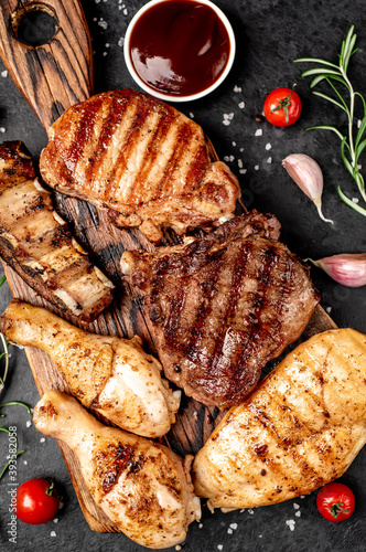 Fototapeta Various types of grilled meat, beef, pork, chicken on stone background obraz