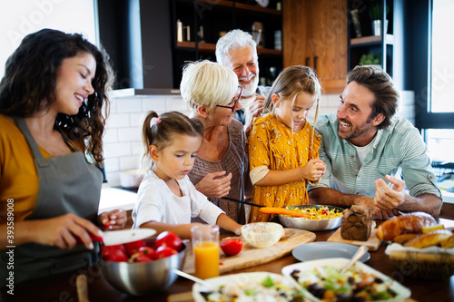 Grandparents, parents and children spending happy time in the kitchen Fototapet