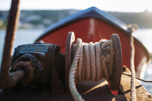 Old Pulley With Rope In A Fishing Boat In The Background The Bow With Sea