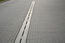 Drainage Element In Interlocking Paving Concrete Gutter With Slotted Drain From One Piece Of Concret Slit Remove Dirt From Traffic Areas Of Highways, Roads Airport, Tunnel, Industrial Area, Parking