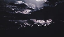 Silhouette Of Lightning In Sky At Night