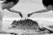 Man And Woman Making Sandcastl...