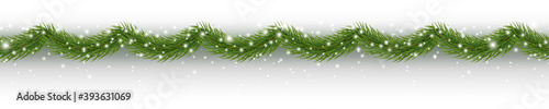 Foto Border with green fir branches, snow isolated on white background