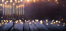 Hanukkah Abstract Defocused Background - Menorah With Bright Dust On Wooden Table