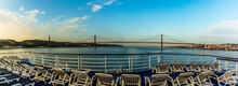 Cruising Up The Tagus River, Lisbon, Portugal At First Light Passing Underneath The Suspension Bridge Named After The 25th April Revolution