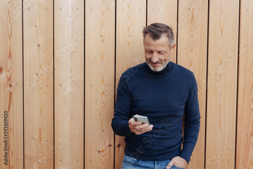 Photo Man checking a message on his mobile phone