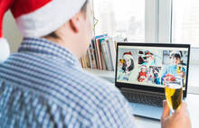 Family Online Video Conference, Christmas Greetings. Virtual Call Through Screen Of Laptop, Tablet, Mobile Phone. Glass Of Champagne, Gift. Remote Conversation With Mom, Wife, Children.Home Isolation
