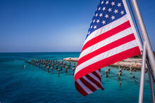 American Flag Waves Over Ruins