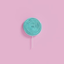 Close-up Of Candy Against Purple Background