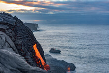 Lava By Sea Against Cloudy Sky At Big Island