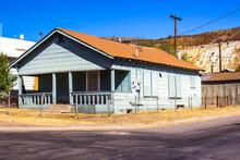 Abandoned Uninhabitable Corner Home With Boarded Up Windows