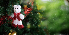 Christmas Tree And White Teddy Bear On Green Bokeh Blur Background. New Year Concept.