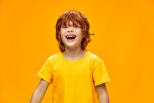 Happy Child Laughs On A Yellow Background Red Hair T-shirt