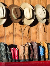 Cowboy Hats And Shoes For Sale On Shelf
