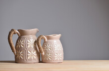 Two Beige Ceramic Jugs For Home Decoration And Flowers