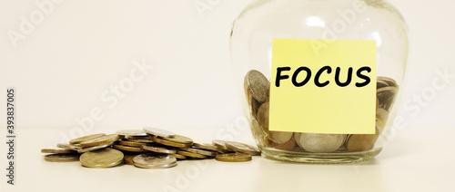 Obraz na plátne Glass jar with coins for savings