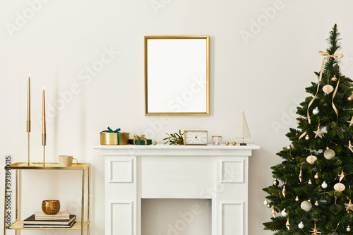 Fotografiet Christmas composition with gold mock up poster frame, white chimney and decoration