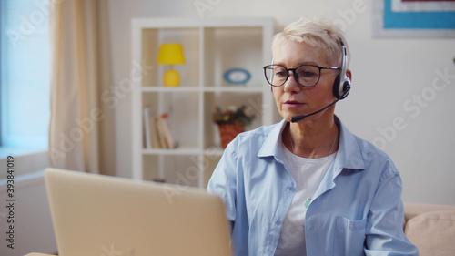 Fototapeta Active senior woman working at home office on laptop obraz