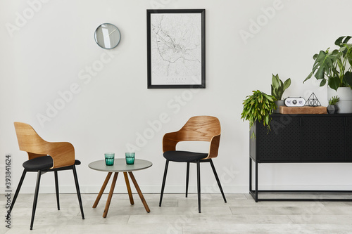 Modern retro concept of home interior with design chairs, coffee table, commode, plants, mock up poster map, decoration and personal accessoreis. Stylish home decor of living room.