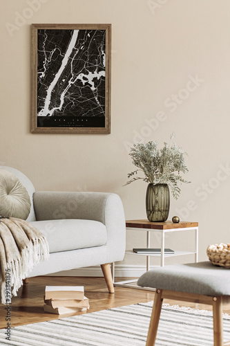 Design scandinavian home interior of living room with mock up poster map, stylish coffee table, gray sofa, plaid, bench, flower in vase and elegant personal accessories. Modern home staging. Template.