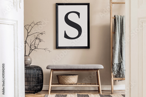 Japandi style living room with mock up poster frame, design wooden bench, unique furniture, decoration and elegant personal accessories. Neutral interior in scandinavian house. Cozy home decor.