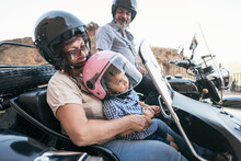 Granfathers With Grandson On Sidecar Bike. Jaen, Spain