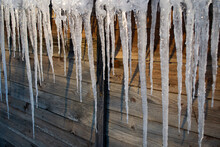 Icicles On The Roof Of A Shed