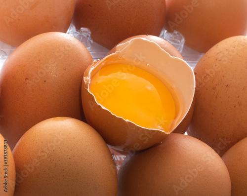 brown eggs with broken egg . Fototapeta