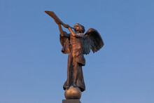 Vilnius Uzipis Angel Sculpture. Beautiful Sunset Light. Sightseeing Place For Artist And Bohemia