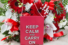 Bouquet Of Red Gerberas, White Orchids And Freesias And A Plate With The Words : Keep Calm And Carry On