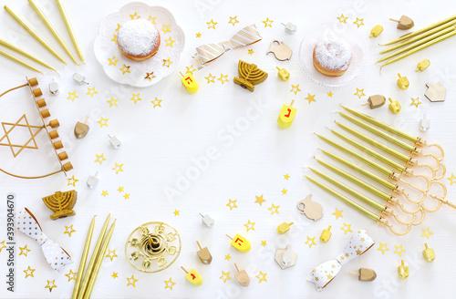 Image of jewish holiday Hanukkah with menorah (traditional Candelabra), donut an Fototapeta