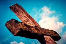 Low Angle View Of Wooden Passion Crucifix  Against Sky
