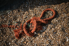 Orange Fishing Rope On A Beach.