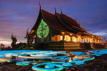 Sirindhorn Wararam Or Phu Prao Temple In Ubon Ratchathani Province In Thailand.  Peaceful Glowing Temple Reflection Of Water During Twilight Sunset And Wonderful To Every Night.
