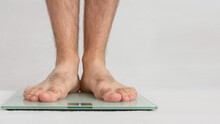 Guy Is Weighed On Scales, Male...